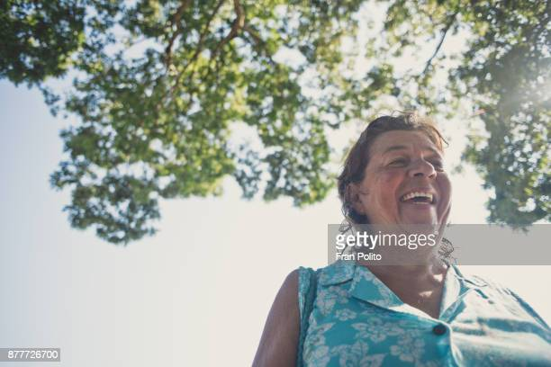 a senior woman laughing. - heart disease stock pictures, royalty-free photos & images