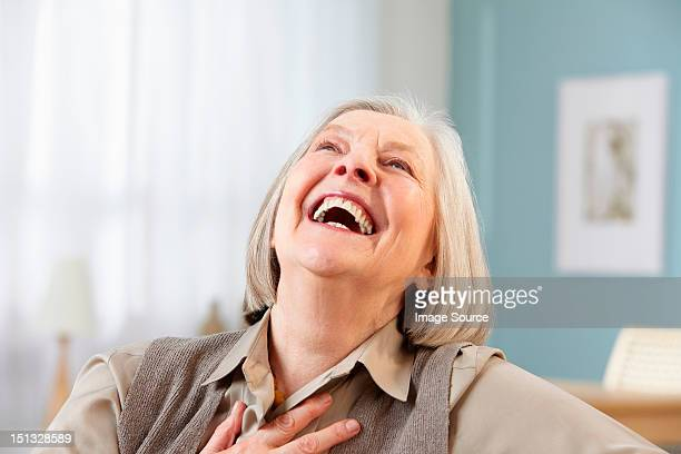 Senior woman laughing, portrait