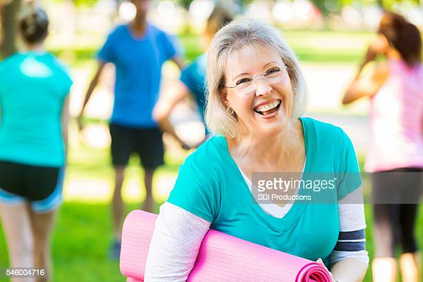Senior woman laughs after exercise class