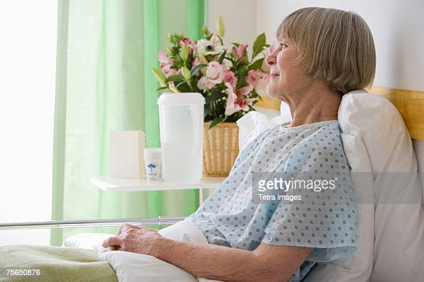 Senior woman laying in hospital bed