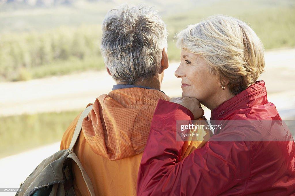 Senior Woman Leaning Against Her Partner's Shoulder : Stock Photo
