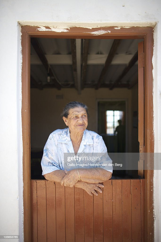 Senior Woman Leaning At Front Door, Paternoster, Western Cape Province,  South Africa :
