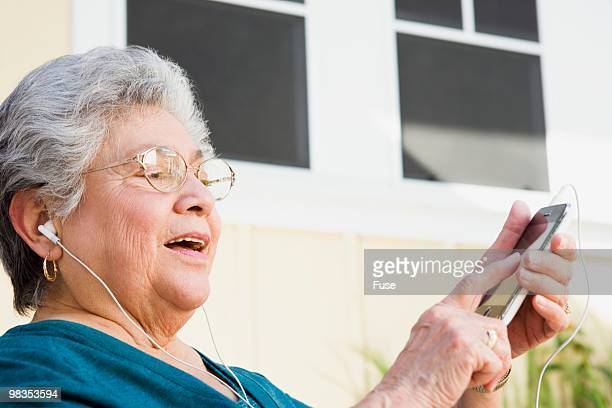 Senior woman listening to an MP3 player