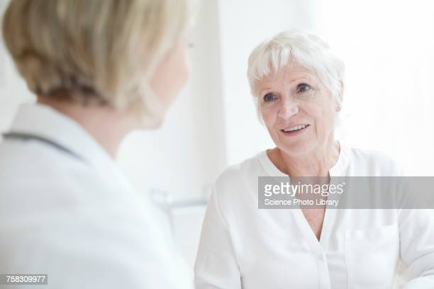 Senior woman listening to female doctor