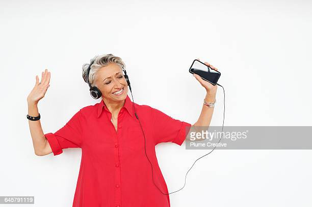 Senior woman listening to music
