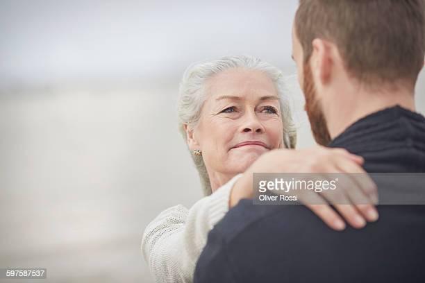 Senior woman looking at adult son