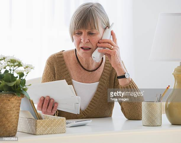 Senior woman looking at bills