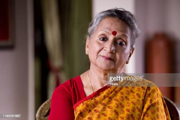 senior woman looking at camera - sari stock pictures, royalty-free photos & images