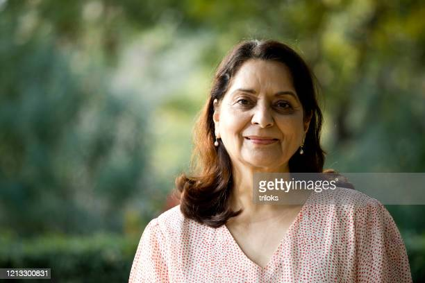 senior woman looking at camera - indian ethnicity stock pictures, royalty-free photos & images