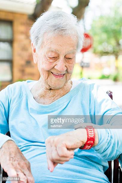 Senior Woman Looking at Her Smart Watch