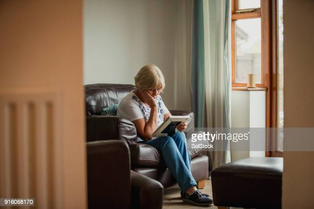 senior woman looking at photo frame - death stock pictures, royalty-free photos & images