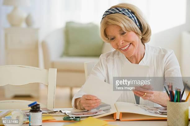 Senior woman looking at photographs