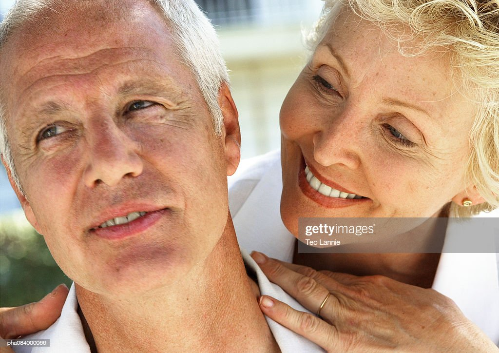 Senior woman looking at senior man, close up. : Stockfoto