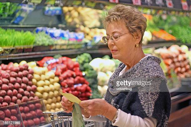 Senior Woman Looking at Shopping List