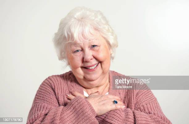 senior woman looking grateful - white hair stock pictures, royalty-free photos & images
