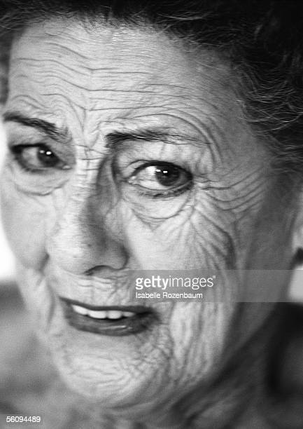 senior woman looking into camera, close-up, portrait, bow. - old ugly woman stock photos and pictures