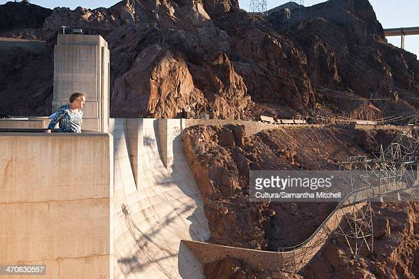 senior woman looking out from hoover dam, nevada, usa - hoover dam stock photos and pictures