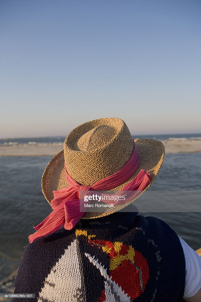 Senior woman looking out over water, rear view : Foto stock