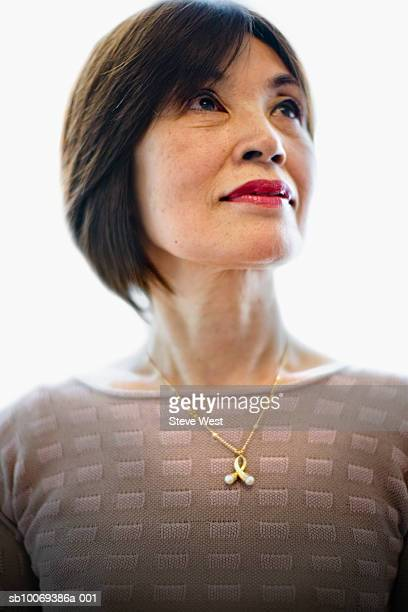 senior woman looking up, smiling - pendant stock pictures, royalty-free photos & images