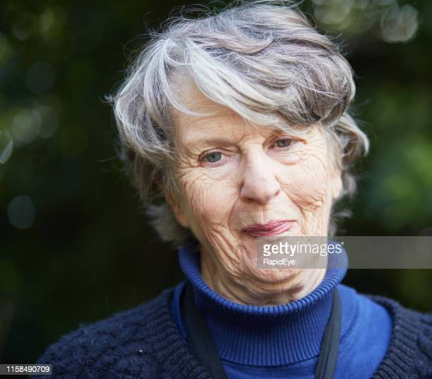 Senior woman looks pleased and content