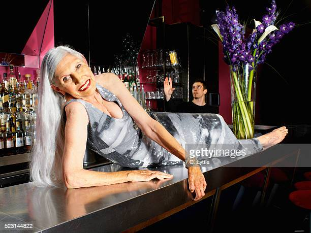 Senior Woman Lying on Bar