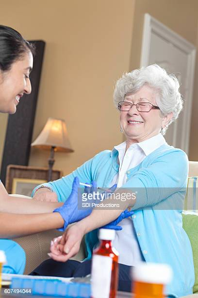 Senior woman makes a face while receiving an injection