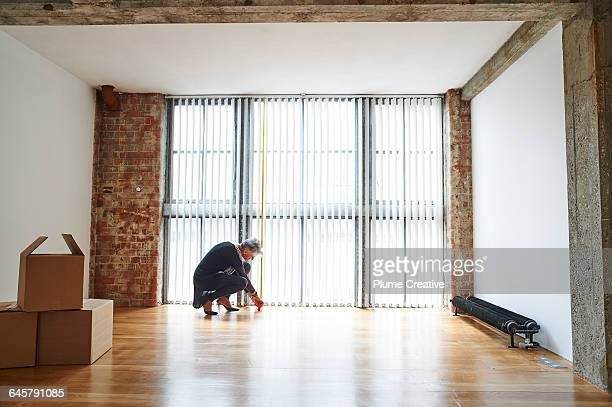 Senior woman measuring new office space