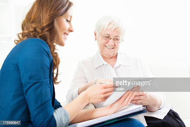 Senior Woman Meeting With Financial Advisor.