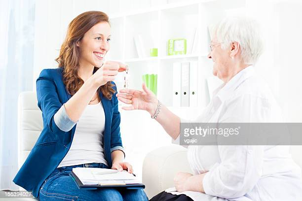 Senior Woman Meeting With Real Estate Agent.