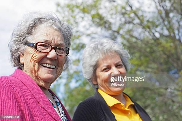 Senior Woman Mother and Mature Daughter Grinning at Camera