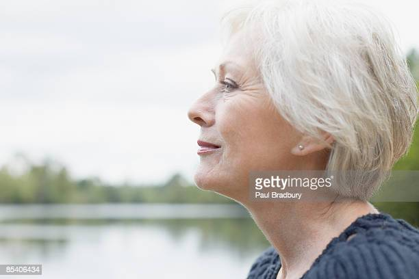 Senior woman near lake