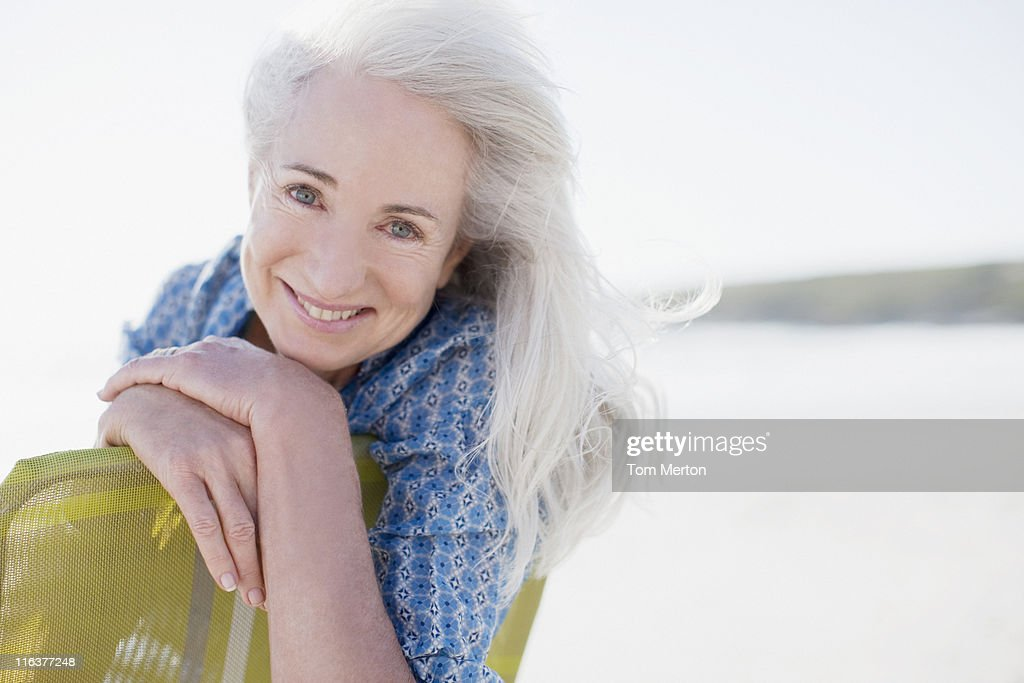 Senior woman on beach : Stock Photo