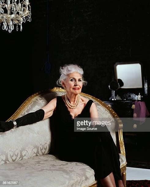 Senior woman on chaise longue