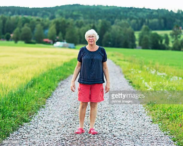 Senior woman on gravel road