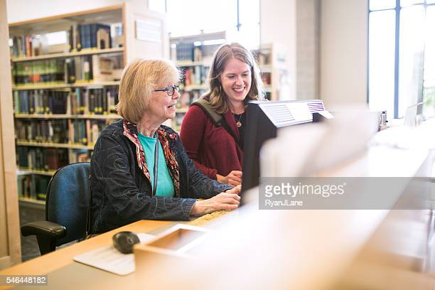 Senior Woman On Library Computer