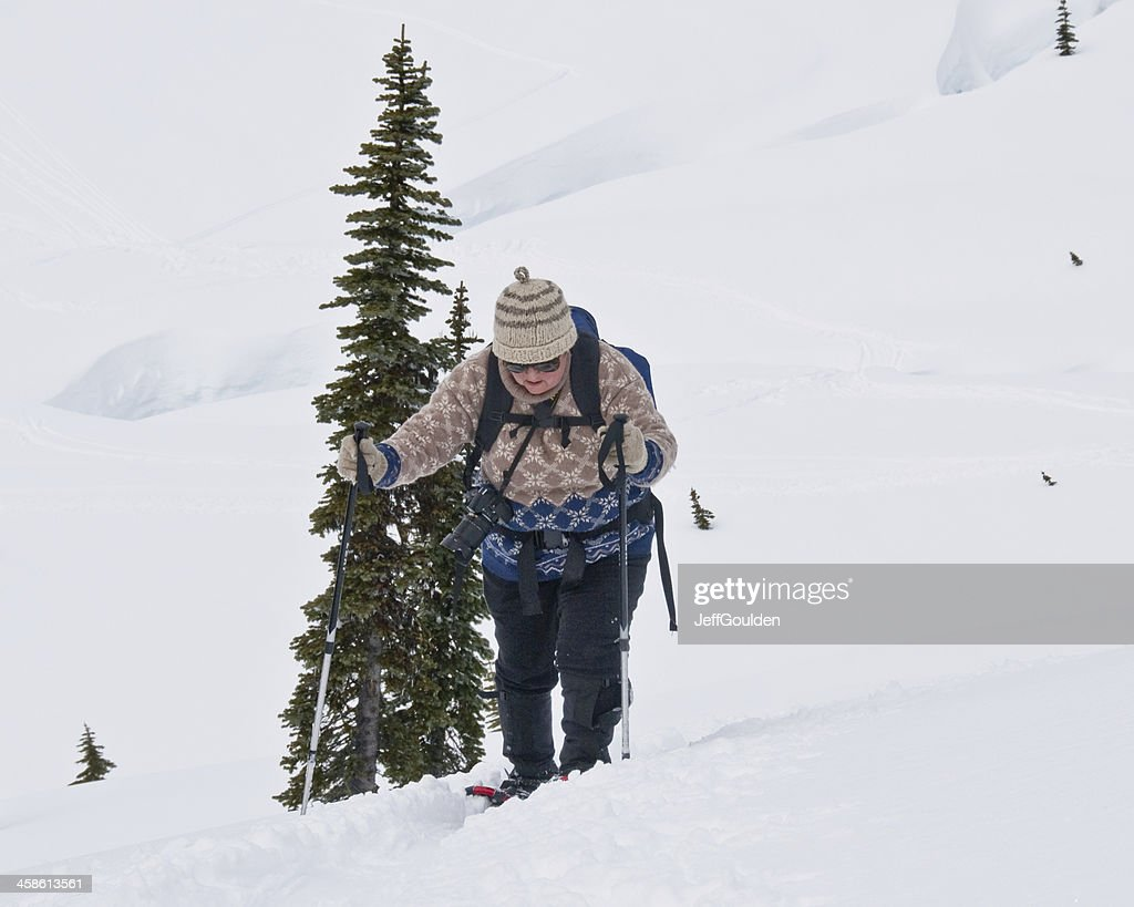 Senior Woman Snowshoing at Mount Rainier : Stock Photo