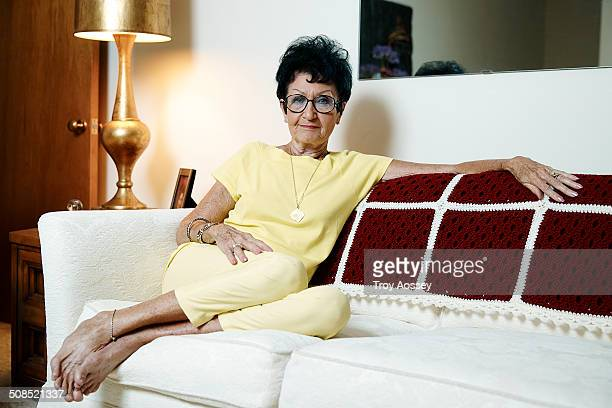 senior woman on sofa relaxed and barefoot - tempe arizona stock pictures, royalty-free photos & images