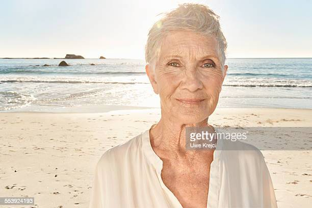 senior woman on the beach, close up - white hair stock pictures, royalty-free photos & images