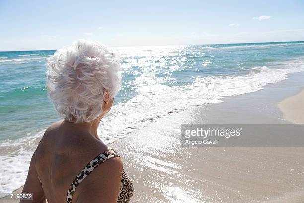 senior woman on the beach - white hair stock photos and pictures