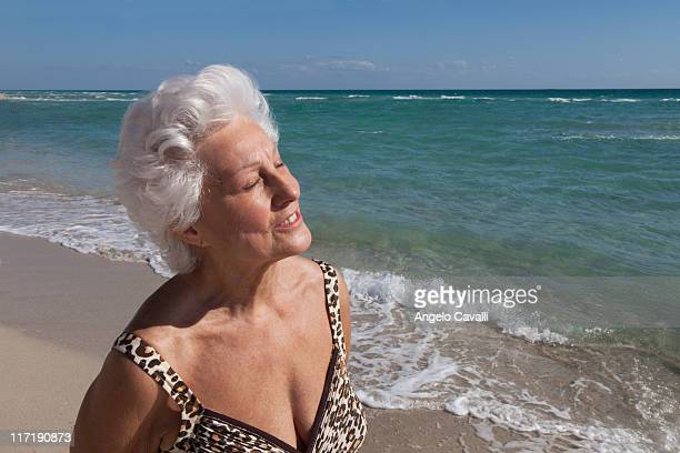 senior woman on the beach - old woman in swimsuit stock pictures, royalty-free photos & images