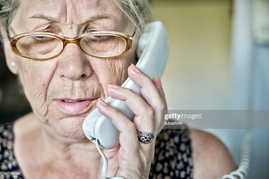 Senior woman on the phone with a look of  surprise : Stock Photo