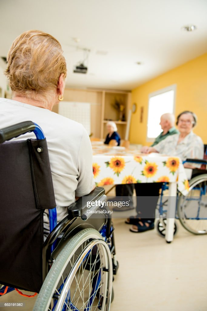 Senior Woman On Wheelchair Waiting In The Dining Room : Stock Photo