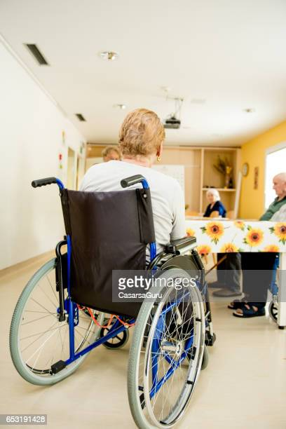 Senior Woman On Wheelchair Waiting In The Dining Room