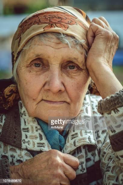 senior woman outdoors - babushka stock pictures, royalty-free photos & images