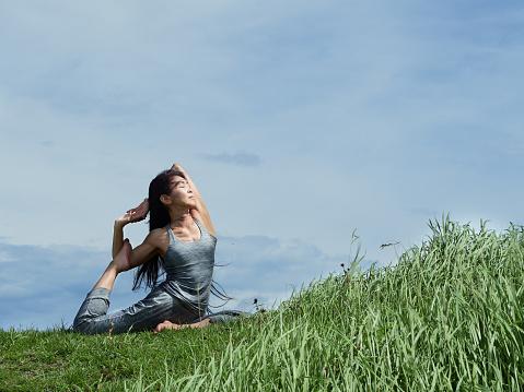 Senior woman outdoors yoga coach - gettyimageskorea