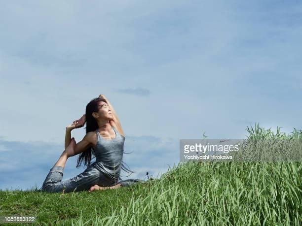 senior woman outdoors yoga coach - yogi stock photos and pictures