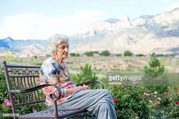 Senior Woman Outside on Bench, Lonely