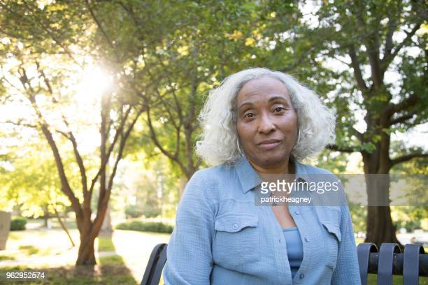 senior woman outside - introspection stock pictures, royalty-free photos & images