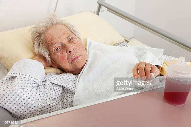 senior woman patient in hosptial - old woman in sick bed stock photos and pictures