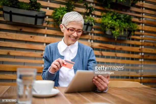 Senior woman paying online.